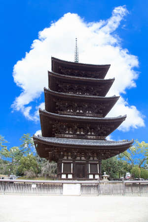 Old five-storied pagoda made wood at Kofuku Temple, Nara Prefecture, Japan The background is sky and cloud. Is a vertical image. Sajtókép