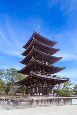 Old five-storied pagoda made wood at Kofuku Temple, Nara Prefecture, Japan The background is sky and cloud. Is a vertical image. Editorial