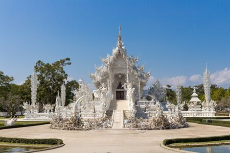 unconventional: Wat Rongkhun or White Temple, a contemporary unconventional Buddhist temple in Chiangrai, Thailand. Stock Photo