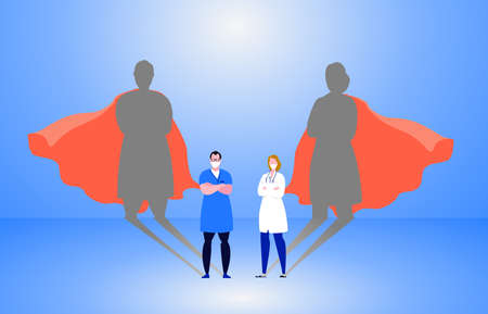 Doctor and nurse wearing medical masks with superhero shadow on the wall. Hospital staff, nurses heroes fight coronavirus pandemic, epidemic. Strong, courage, brave life saving medical .