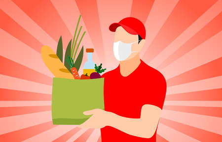 Delivery man holding a bag with food, Vegetables, Bread and Wine,he is wearing a face mask ,safe food delivery at home.