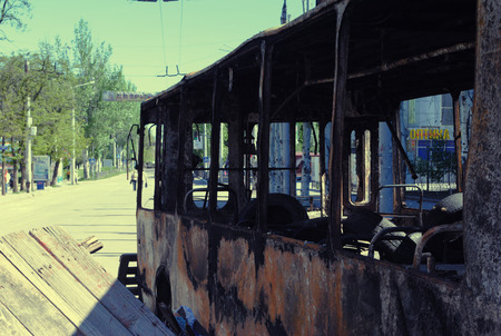 burnt out: Burnt out trolley bus used as a primitive barricade for home defence of Kramiatorsk, Donetsk Region, Ukraine