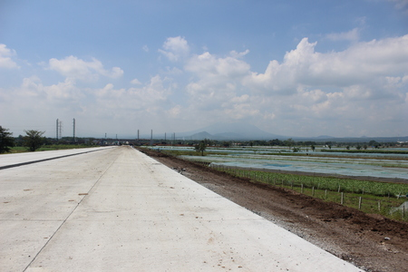 Concrete Road Near Rice Fields in Indonesia