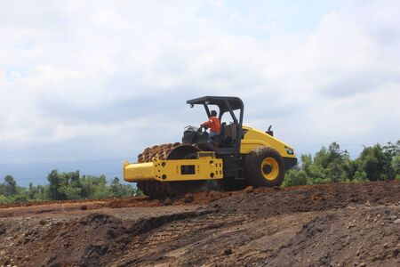 construction machinery is working on road projects and building structures Stock Photo