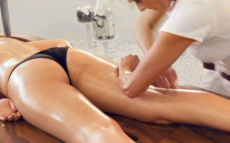 Woman in a day spa on classic massage