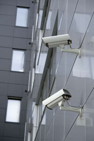 attached: Security cams attached on corner of the building
