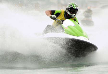 water skier: Riding the jetski Stock Photo