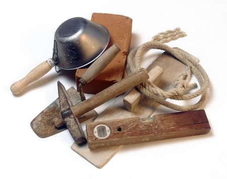 Masons tools isolated on white background photo