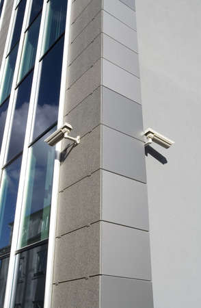 Two security cameras attached on building corner Stock Photo - 890796