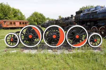 Old train wheels in retro train park photo