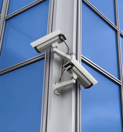 Two security cameras attached on building corner Stock Photo - 1536772