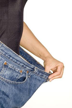 Trying jeans pants after strong diet isolated on white background