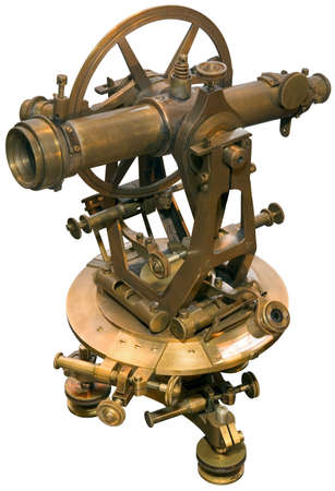 Old brass theodolite isolated