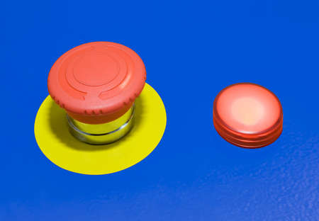 Panic alert button isolated on blue background Stock Photo - 9753454