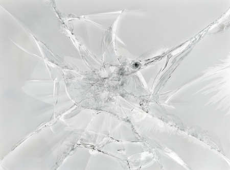 Gray background of cracked glass photo