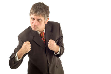 animosity: Angry businessman in aggresive boxin pose isolated on white background