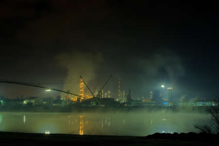 Smog production by oil refinery photo