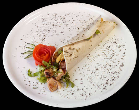 Turkish kebab on white plate cutout with clipping path on black background photo