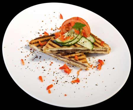 Toasted Triangular Sandwiches on White Plate Isolated on Black Background Stock Photo - 12308597