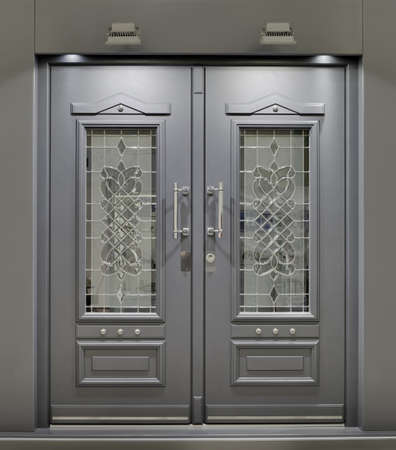 glass doors: Massive Metallic Fireproof Front Door