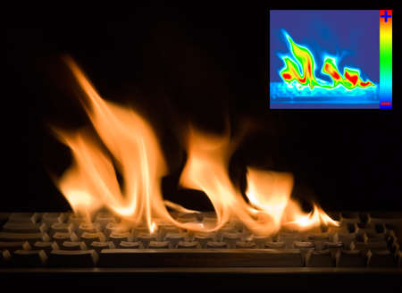 heat radiation: Burning Keyboard with Thermal Image Diagram for Damage Detection Stock Photo