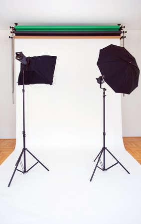 studio photography shot: Empty Photo Studio with Lights and White Backdrop Stock Photo