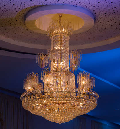 shimmery: Shimmery Christal Chandelier Hanging from Ceiling Editorial