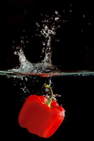 Red Paprika making a Splash in Water Stock Photo - 17571457