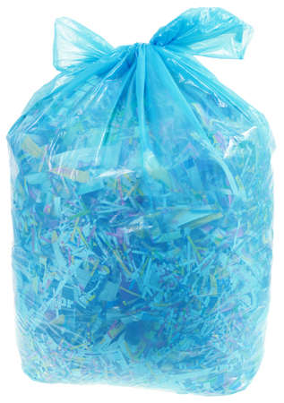 shreds: Paper Shreds in Transparent Plastic Bag for Recycling Isolated on White Background Stock Photo