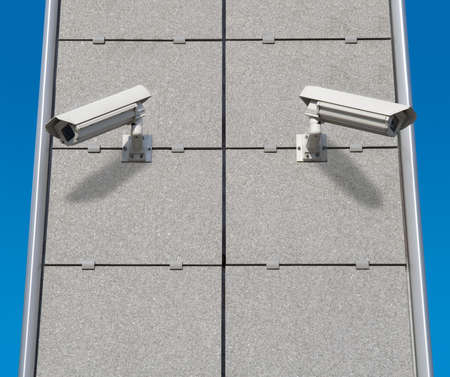 Two Security Cameras Monitoring at Different Directions photo