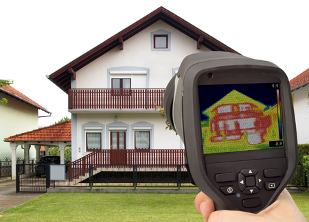 Heat Loss Detection of the House Facade With Infrared Thermal Camera Stock Photo
