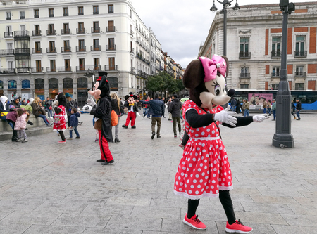 Madrid, Spain. April 30, 2017 : People in costumes of Minnie and Mickey Mouse are walking to entertain tourists on the street of Plaza Puerta del Sol.
