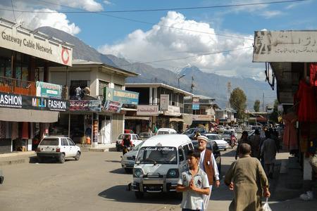 Gilgit, Pakistan. October 6, 2015 : People walking along the shopping street at NLI Market. Editorial