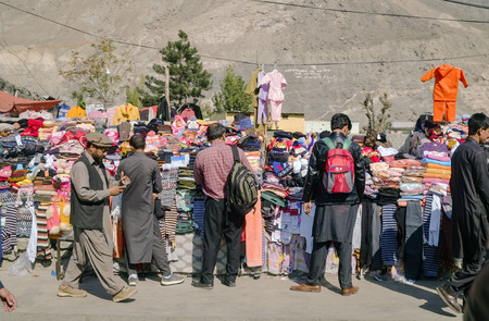 Gilgit, Pakistan. October 30,2017 : People choosing goods at a local clothes stall.