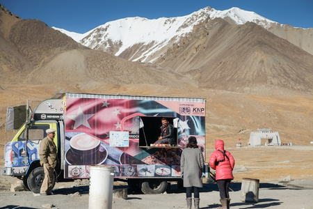 Khunjerab Pass, Pakistan. October 30,2017 : Women tourists talking with a man selling food at the Pak-China border.