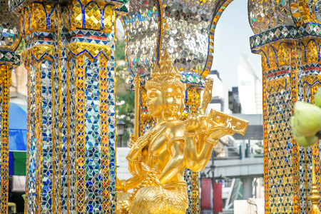 Golden statue of four-faced Thao Maha Phrom at the Erawan Shrine. Bangkok, Thailand.