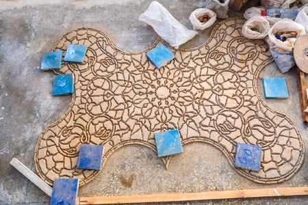 Face-down pieces of Zellige terracotta glazed tiles to form a Moroccan mosaic pattern. Medina of Fez, Morocco. Standard-Bild