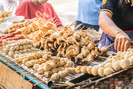 Charcoal grilled food brochette for sale at a local market in Bangkok, Thailand.