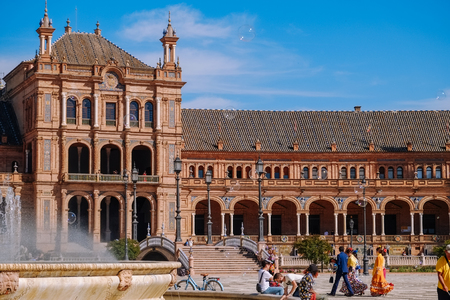 Seville, Spain. May 4, 2017 : People enjoy sightseeing at the Plaza de España in April fair or Feria De Abril period. Editorial