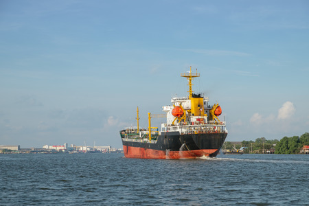 A chemical tanker ship designed to transport liquid chemicals and petroleum products. Chao Phraya River, Bangkok, Thailand.