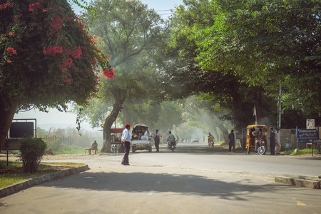 Taxila, Pakistan. October 4, 2015 : Pakistani people on shady street in front of the Taxila museum near Dharmarajika Stupa with natural sunlight at the morning, Punjab.