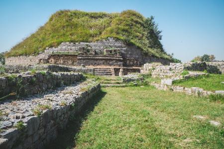 Ruin and ancient historical Buddhist Dharmarajika Stupa. Site in Taxila. Punjab, Pakistan.