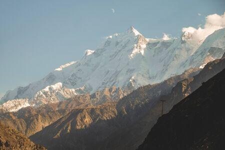 Close up view of snow capped Rakaposhi mountain in Karakoram range in Nagar valley. Gilgit Baltistan, Pakistan.