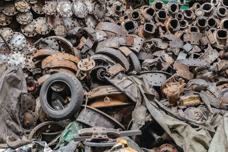 Heap of recyclable old dirty junkyard used car engine scrap machine and rust auto parts industry in scarp yard.