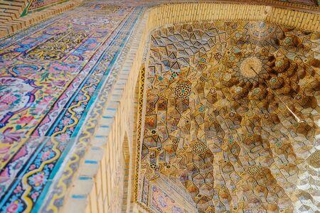 Shiraz,Iran. October 24,2016 : Colorful vintage Persian Iranian pattern muqarnas vaulting ceiling mosaic tiles Islamic art decoration at Nasir al-Mulk mosque, Fars province.