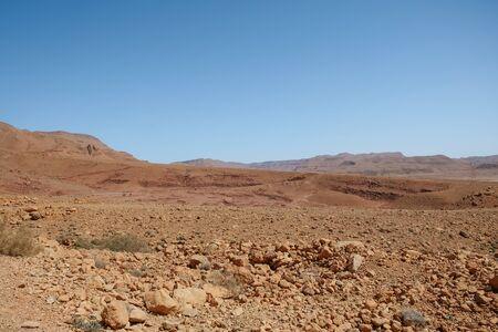 Drought land desert arid landscape against clear blue sky Banque d'images