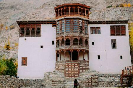 Facade and main entrance of ancient Khaplu fort palace in autumn, famous tourist destination landmark in Ghanche. Gilgit Baltistan, Pakistan.
