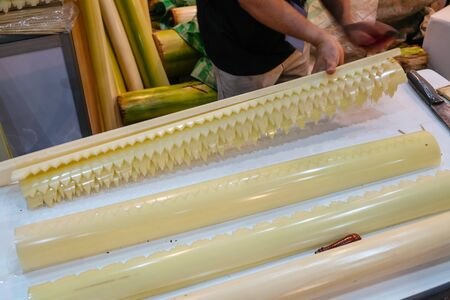 Bangkok,Thailand. Jan 31,2020 : Carved and perforated banana stalk pith natural material on the table for making handmade handcraft traditional Thai artwork