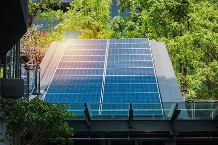 Photovoltaic solar power panels renewable energy installed on modern building rooftop in the city. Eco green clean alternative power energy innovation concept