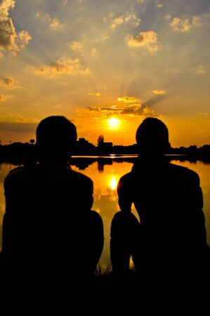 two boys and sun set photo